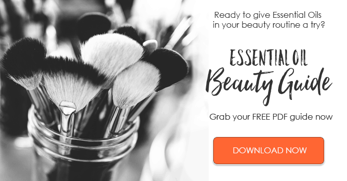 black and white photo of makeup brushes with text for Essential oil beauty guide