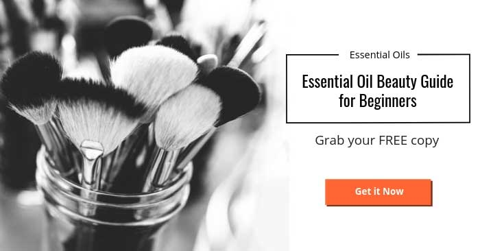 black and white photo of makeup brushes and text for an essential oil beauty guide