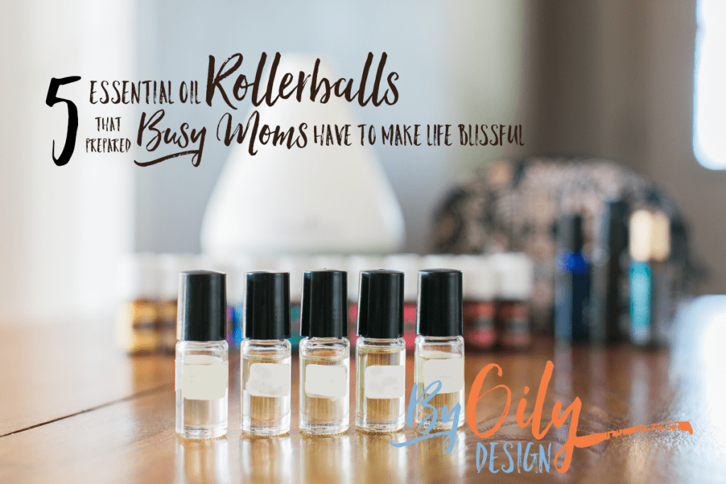 Row of 5 clear glass roller bottles with essential oils for kids. behind is a row of premium starter kit oils, diffuser, more rollers and a small bag.