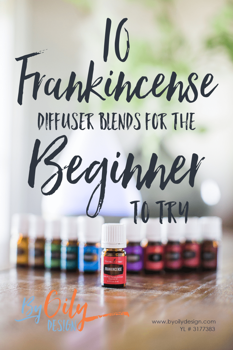 bottle of frankincense on a wood table with other essential oils in the back ground