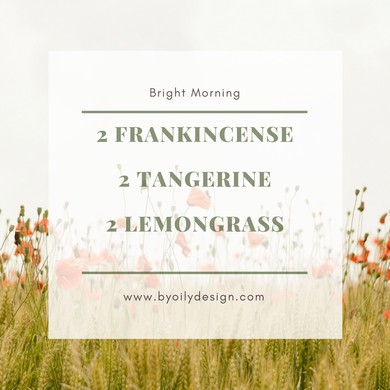 Frankincense DIffuser Blend called Bright morning laid in text over orange flowers and grass