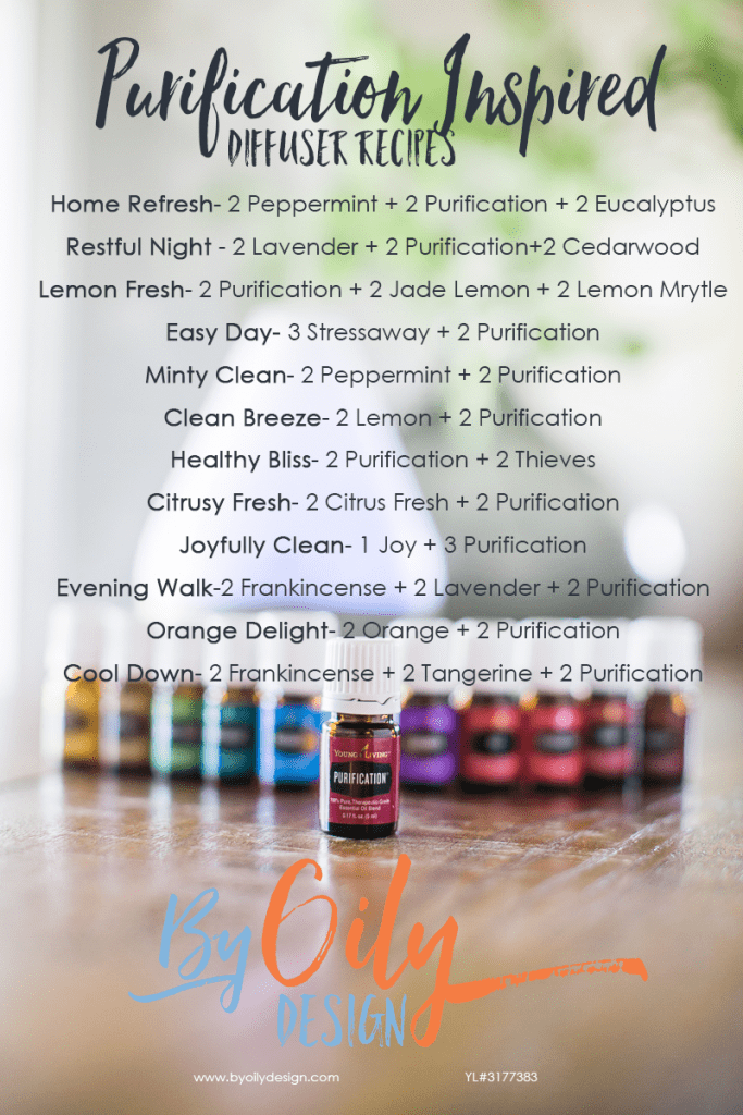 Bottle of purification in front of a row of premium starter kit oils and diffuser.