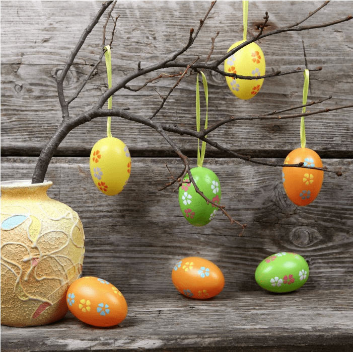 tree branch with plastic decorated Easter eggs