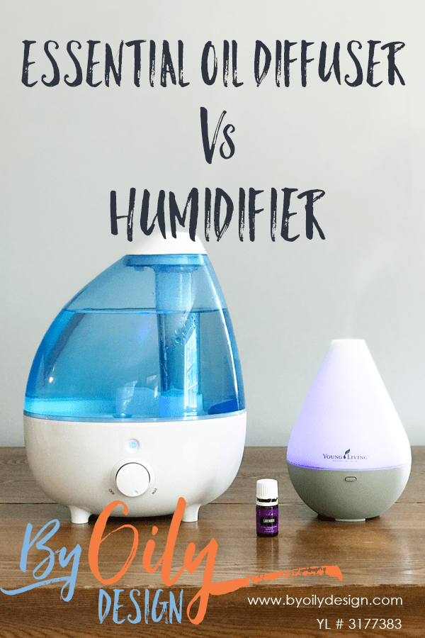 essential oil diffuser and humidifier on a table with a bottle of lavender oil