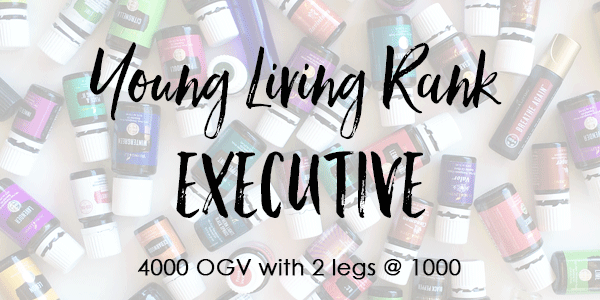 Text over lay of essential oil bottles- Young Living Rank of Executive 4000 OGV with 2- 1K legs.