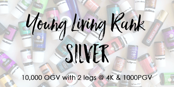 Text over lay of essential oil bottles- Young Living Rank of Silver 10,000 OGV with 2- 4K legs & 1000pgv