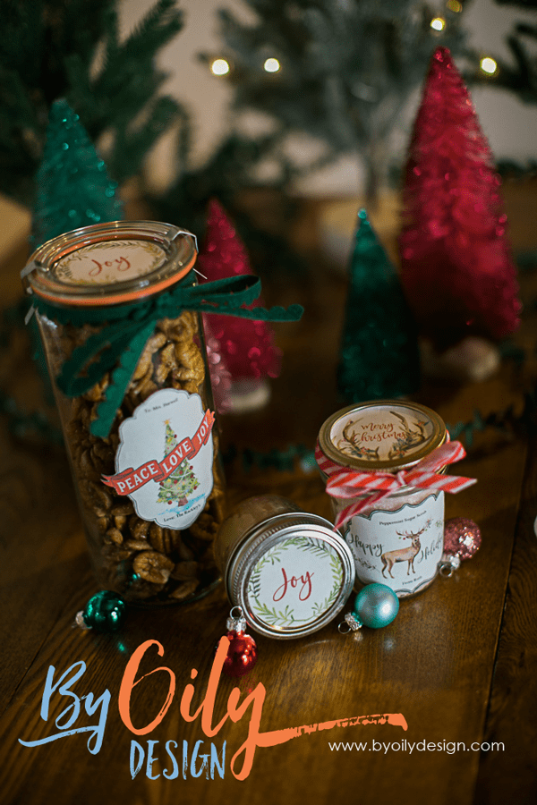 essential oil Christmas Gifts with free printable Christmas labels on a wooden table with simple Christmas Decor