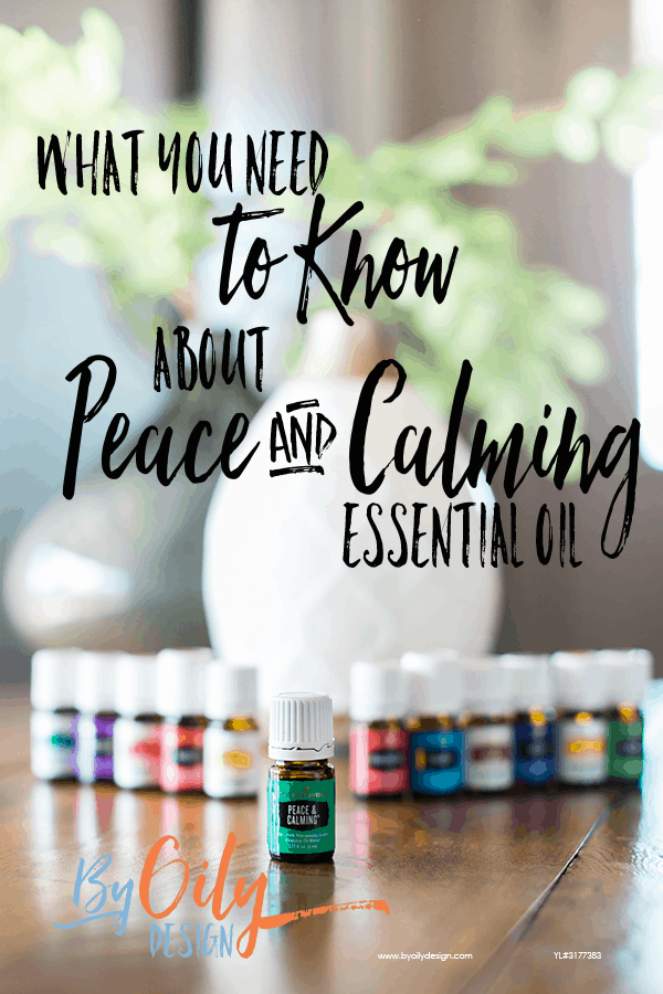 bottle of peace and calming essential oil with 11 other young living essential oils and a desert mist diffuser behind the oils. All are on a wooden table by a window with a plant