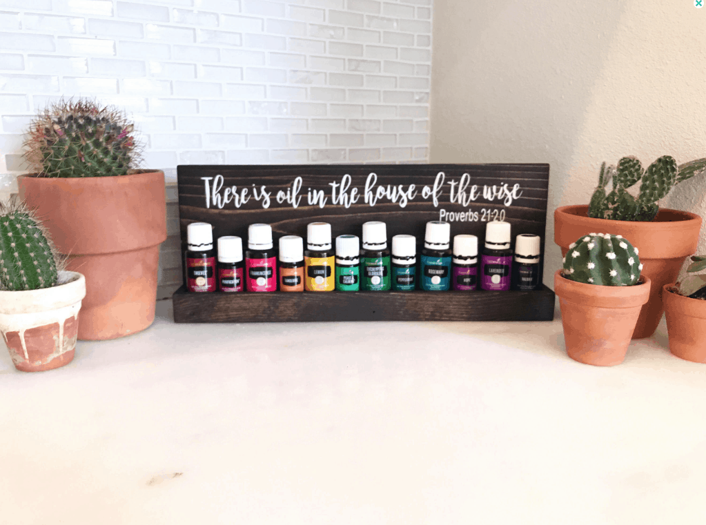 small essential oil shelf with bible verse