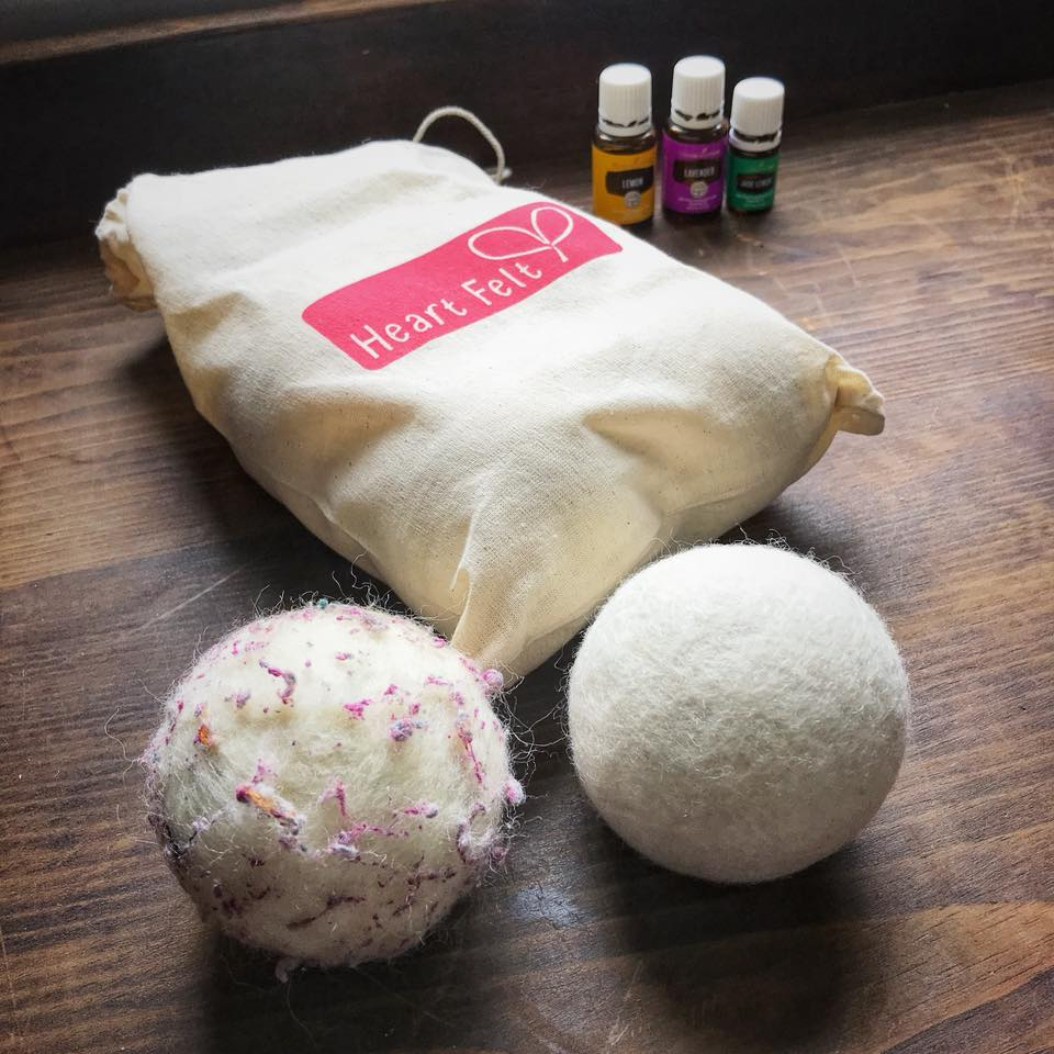 Wool balls used in laundry to help dry clothes. Pictured with essential oils