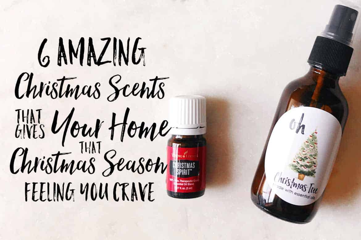 bottle of young living Christmas spirit with a room spray bottle next to it.