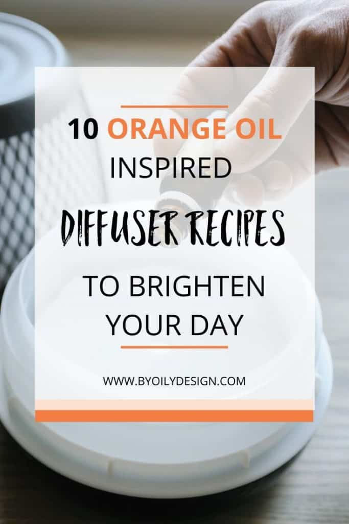 someone placing drops of orange essential oil into a diffuser.