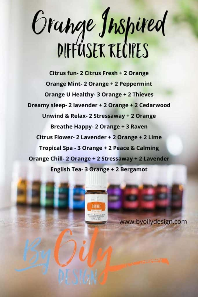 bottle of Orange essential oil on a table with other essential oils and a diffuser.