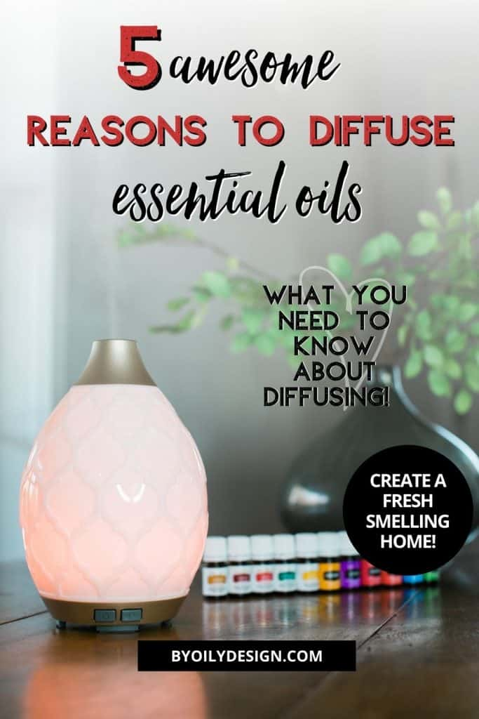 row of oils next to an essential oil diffuser. oil in diffuser is diffusing.