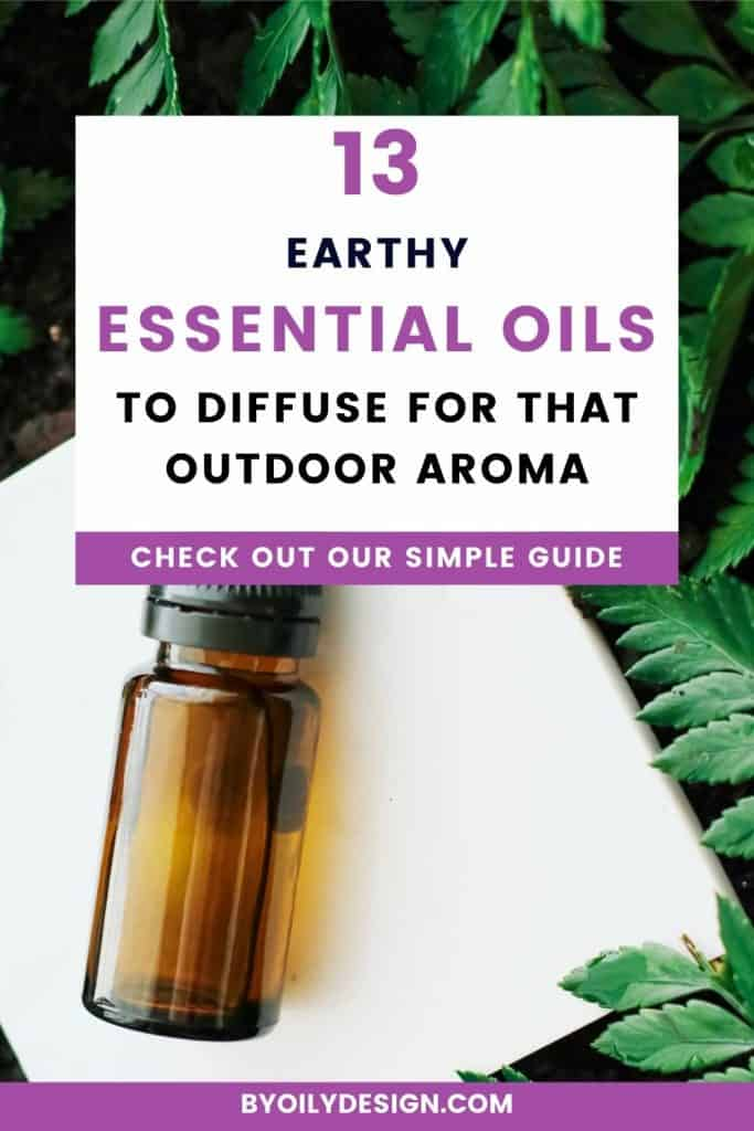 essential oil bottle surrounded by fern leaves with the text 13 earthy essential oils to diffuse
