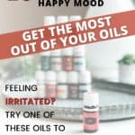"Image of 14 essential oils made into a tower with one oil out front. text on image says ""15 of the best oils for a happy mood"""