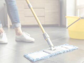 woman using all natural homemade floor cleaner to mop her tile floor.